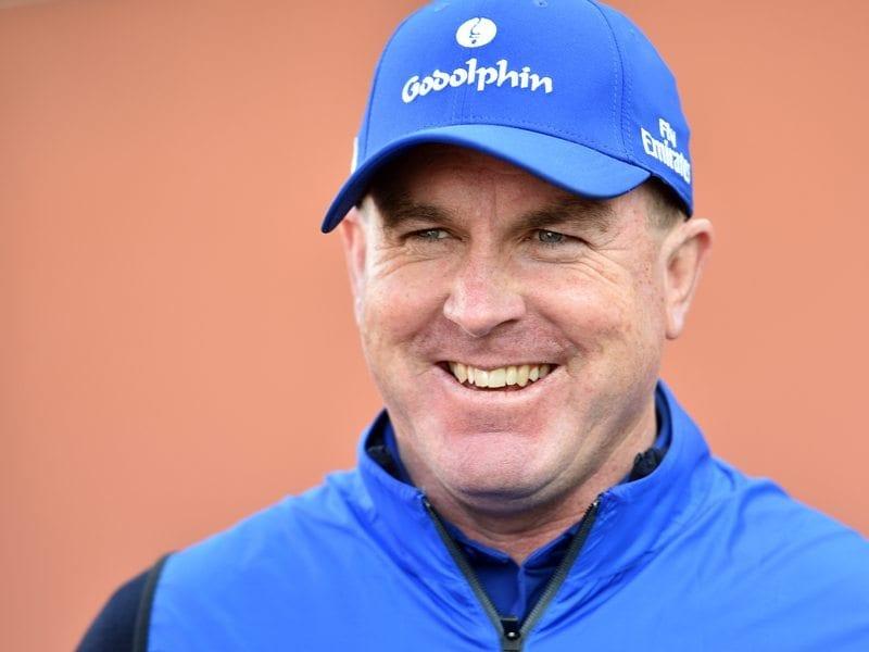 Trainer John O'Shea speaks to the media
