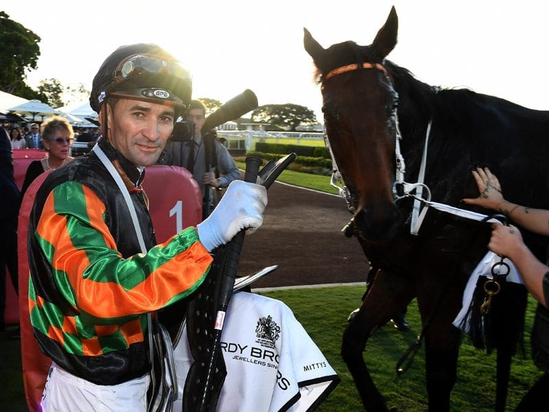Jockey Corey Brown gestures after riding Sense of Occasion to victory