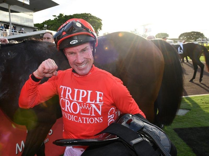 Jockey Jim Byrne celebrates