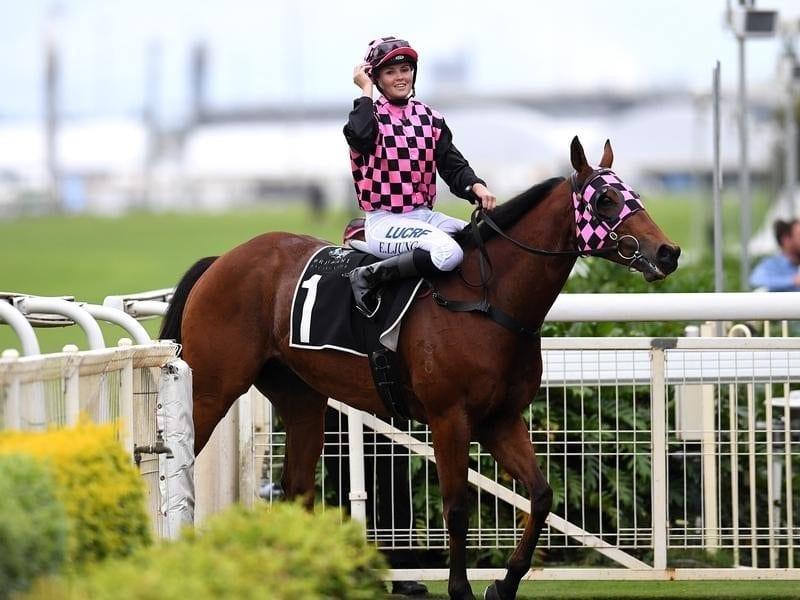 Jockey Emma Ljung smiles after riding Hopfgarten to win