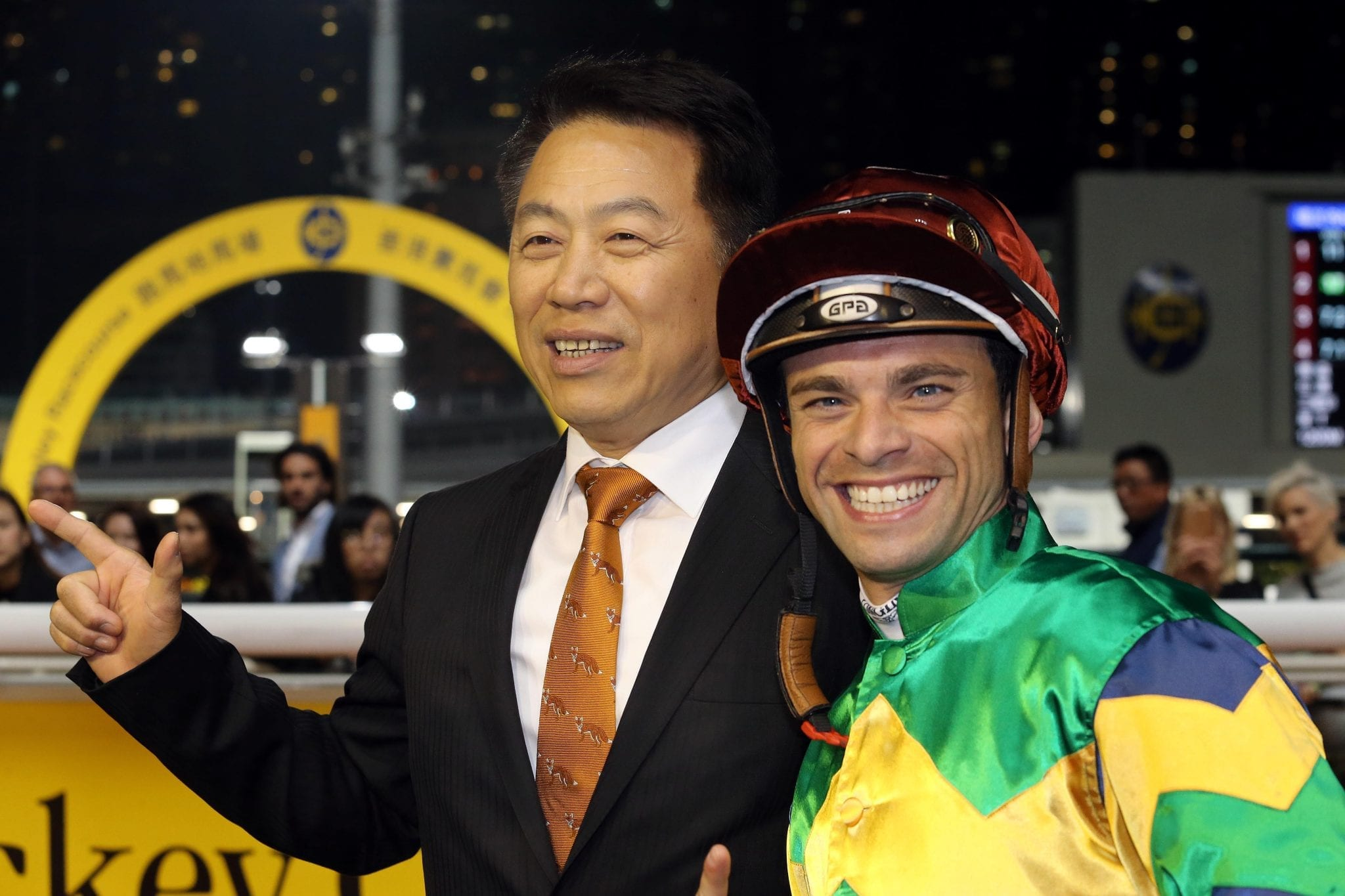 Trainer Ricky Yiu celebrates his 700th career win