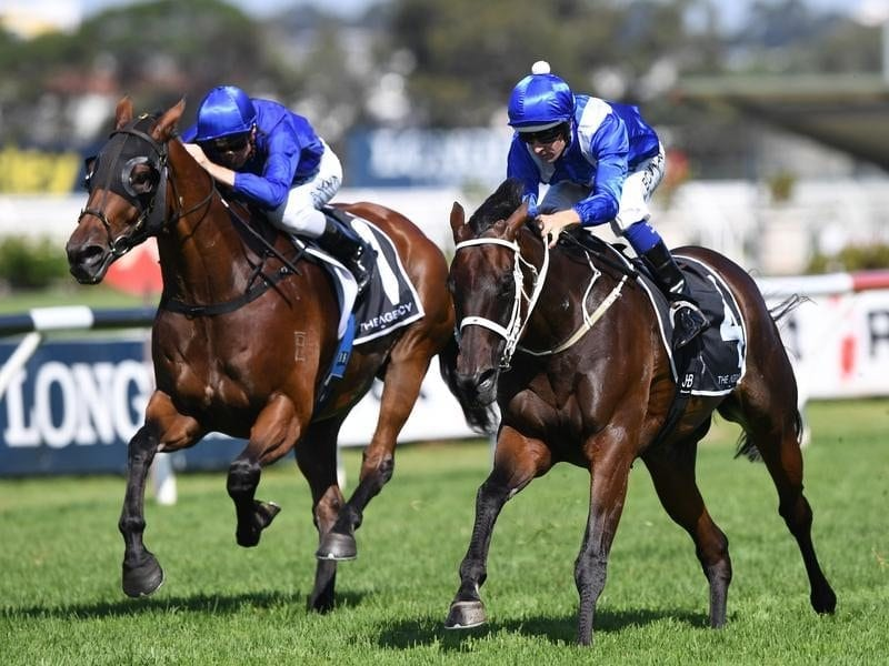 Winx ridden by Hugh Bowman (right)