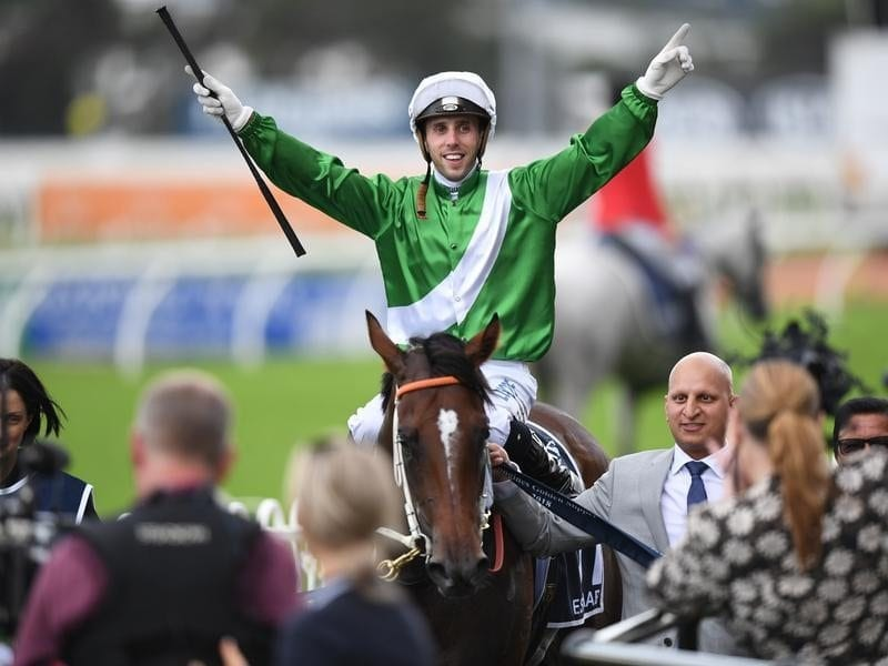 Jockey Brenton Avdulla on Estijaab gestures to the crowd.