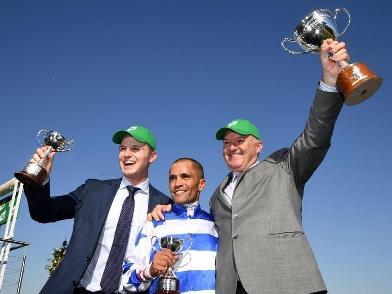 (L-R) Trainer Ben Hayes, jockey Michael Walker and trainer David Hayes