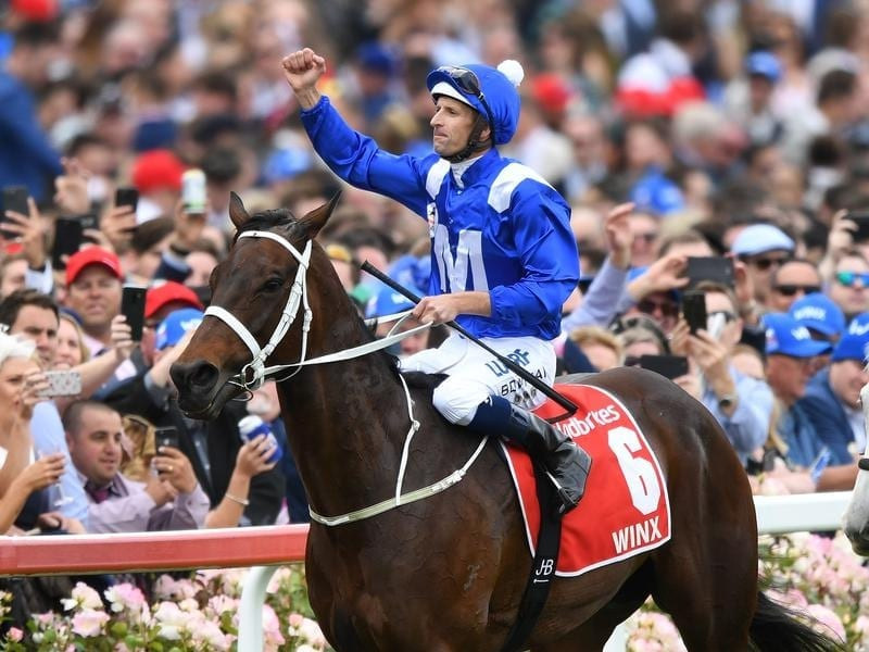 Jockey Hugh Bowman reacts after riding Winx.