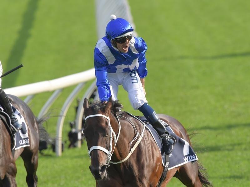 Jockey Hugh Bowman rides Winx to victory in the Queen Elizabeth.