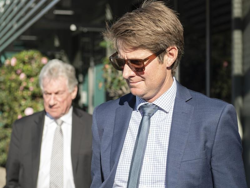 Trainer Jarrod McLean leaves a disciplinary hearing in Melbourne.